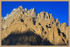 Shadows of Evening (IshtiaQ Ahmed revival to Photography) Tags: china pakistan sunset 6 mountain golden evening town shadows village glaciers pasu 20 hunzariver boarder passu tupopdan gojal passucathedral passucones 106metres 033ft
