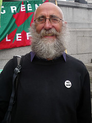 Smiling Professor Tim (Kombizz) Tags: uk portrait london smiling beard happy glasses tim bald photojournalism trafalgarsquare demonstration badge professor greenparty nowar 2718 kombizz professortim smilingprofessortim