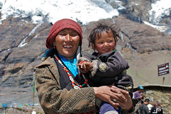 Smiling under the glacier (5.200 mt) (docpap) Tags: woman snow mountains ice smile smiling child mother pass son tibet glacier mum mummy lhasa