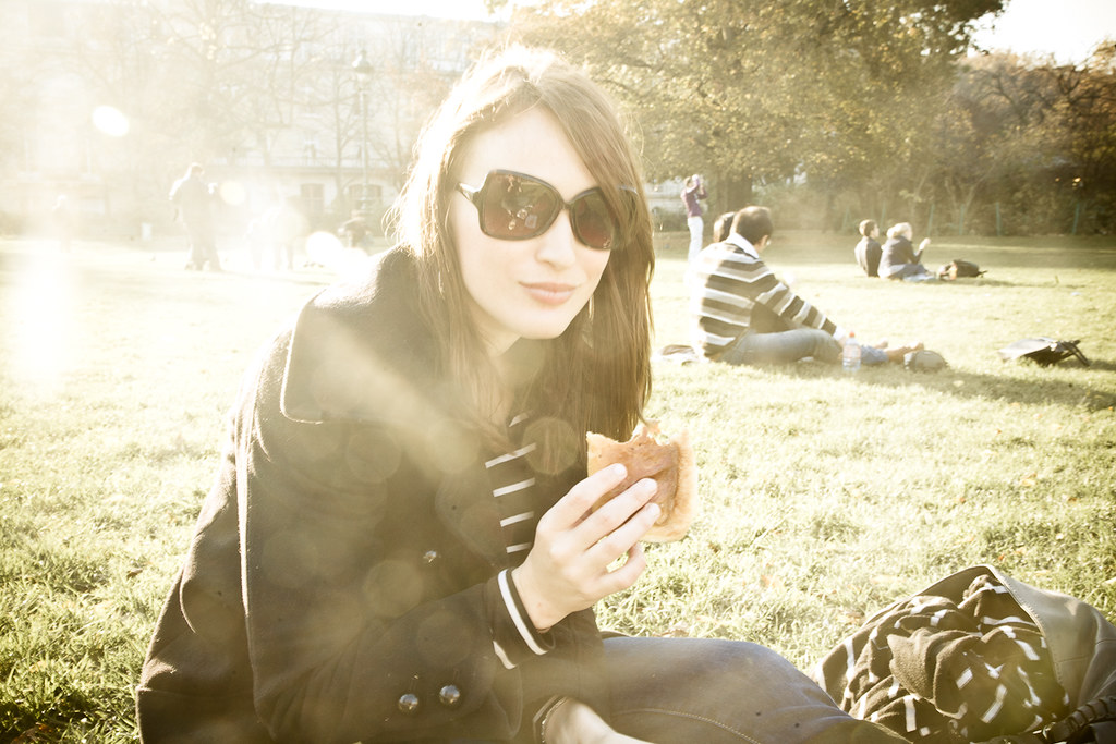 Holly picnicking next to the Eiffel Tower