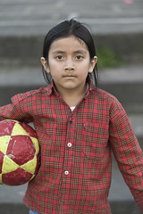quitonr11061.jpg (keithlevit) Tags: latinamerica southamerica childhood vertical closeup standing ball outdoors photography football quito ecuador day child serious soccer sphere soccerball oneperson frontview casualclothing capitalcities colorimage lookingatcamera buttondownshirt waistup focusonforeground onegirlonly elementaryage onechildonly underthearm