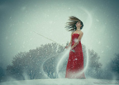 Aello (Kathryn Denman) Tags: blue trees red snow motion girl hair wind sword snowing breeze reddress gust hairflip kdenmanphotography girlholdingsword