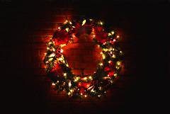 Dark Red Wreath (hpaich) Tags: christmas light holiday brick wall circle festive lights bricks wreath bow merry