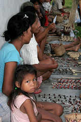 Local Trade on the Amazon (cowyeow) Tags: poverty travel girls people cute peru latinamerica southamerica water girl kids river beads amazon rainforest village market sweet crafts poor jewelry jungle tropical marketplace curious trade loreto peruvian madreselva amazonriver