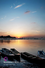 Just before the time (RzzA) Tags: city pink pakistan sunset color colour nature clouds river landscape boats evening three boat bed nikon raw day 5 bank ravi end punjab reza lahore d90 rzza wwwstudiorbiz muhammedrzzaphotography