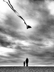 Kite (FotoFleeby) Tags: sea woman cloud white kite black beach silhouette skyline