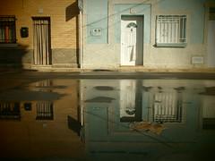(sonyacita) Tags: street houses reflection water puddle leaf spain cintruénigo