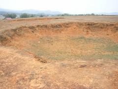 Large bomb crater (Laos 2006) (paularps) Tags: travel holiday nature vakantie flickr culture olympus 2006 leisure laos bombing reizen flickrcom destinations vakantiefotos c300z adventuretravel arps paularps