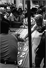 Gambling Colombian (Indian_Forever) Tags: street blackandwhite bw film public 35mm photography colombia outdoor candid streetphotography biancoenero reportage pellicola documentaryphotography barrancabermeja blackwhitephotos streetfotografie