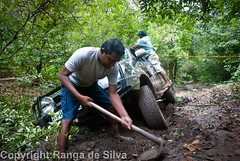 Cutting a path (RangadeSilva) Tags: clearingapath cuttingaroad digging endurolanka kumana mud nikond80 offroading rangadesilva srilanka teamwork vehicleabouttotipover vehiclestuckinmud