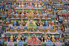 Camouflaged! (VinothChandar) Tags: roof light india abstract man building tower statue architecture canon temple photography lights photo colorful photos vibrant amman statues lord pointofview hidden camouflage gods hiding madurai tamilnadu almighty hideout meenakshi gopuram