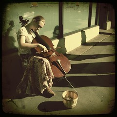 she played pretty music (Janine Graf) Tags: seattle musician music woman pretty cello pikeplacemarket streetmusician iphoneography hipstamatic floatfilm janine1968 iphone4s tejaslens