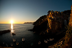 """It is almost impossible to watch a sunset and not dream."" (webeagle12) Tags: ocean park sunset sea vacation italy orange house fish eye bay coast boat nikon europe riviera italia village dusk 10 liguria cliffs fisheye national tiny terre mm nikkor cinque riomaggiore ligurian d90 thefivelands"