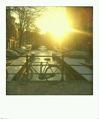 Covered in snow (Vlien*) Tags: city morning winter light sun snow cold holland dutch amsterdam bike sunrise polaroid canal leliegracht flickrandroidapp:filter=berlin