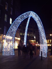 2011 Christmas Lights, South Molton Street, London (Cybermyth13) Tags: christmas street xmas uk blue england white reflection london wet shop night shopping dark stars lights evening arches londonist southmolton 2011