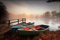 Mistbow & Boats Stairdam (angus clyne) Tags: uk morning autumn winter light wild two mist lake holiday fish snow cold tree art ice water field forest photoshop canon river print dawn for scotland pier boat rainbow pond oak europ