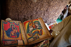 Holy book in a monastery of Tana lake. Ethiopia (NeSlaB .) Tags: poverty africa woman church colors canon religious island book photo women christ cross faith prayer religion jesus monk celebration holy monastery christianity ethiopia orthodox rite pilgrim rites developingcountries reportage pilgrims debre amhara tigray tanalake neslab