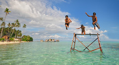 Sibuan Island, Semporna - 1-2-3 Jump! (Mio Cade) Tags: boy sea rain weather swim children fun island kid jump bath child play joy visit tourist malaysia gypsy sabah polarization semporna bajau sibuan