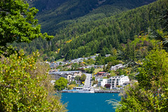 Queenstown through the trees (Kalabird) Tags: new zealand southisland otago queenstown lakewakitipu azureblue