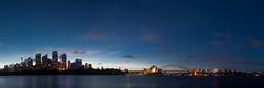 Sydney Harbour (lights+shades) Tags: city sunset sky panorama reflection water skyline canon lights cityscape colours harbour sydney sydneyharbour sydneyoperahouse sydneyharbourbridge gardenisland farmcove mrsmacquarieschair 50d