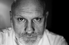 Shot in the face.. (Bas Tadema) Tags: gay white man black beard grey nikon bald tshirt bearman 35 kaal baard grijze mm8 d5100