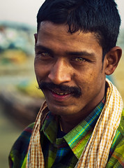 The face of labour... (Rakesh JV) Tags: street portrait india color green smile marina photography construction eyes nikon indian details ngc 85mm story worker f18 chennai gaze powerful tamil jv nadu rakesh cwc d7000 chennaiweekendclickers