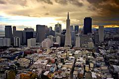 San Francisco Skyline at Sunset (Tony Webster) Tags: sanfrancisco california city sky urban orange storm skyline clouds dark coittower cbd ccbyncnd importsfb ccbync20150103 cgf1512