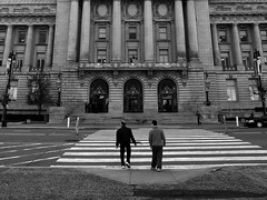 Waiting to Cross (sirgious) Tags: sanfrancisco bw cityhall pedestrians crosswalk civiccenter midblock sftr