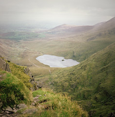 up or down, it's halfway there (manyfires) Tags: ireland mountain lake film mediumformat square landscape lough hiking eire hasselblad trail ascent countykerry hasselblad500cm carrauntoohil devilsladder