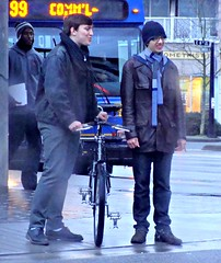 Tweedle Twins (knightbefore_99) Tags: street winter cold rain station bicycle vancouver corner bc candid grin skytrain commercialdrive eastvan nerdy jovial thedrive