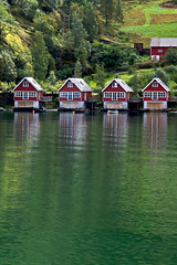 Fjord boathouses (Rozanne Hakala) Tags: houses green tourism water norway reflections outdoors norge explore fjord scandinavia flm flam sognefjord boathouses aurlandsfjord sognefjordinanutshell worldslongestanddeepestfjord littleplacebetweensteepmountains touristff rozannehakala