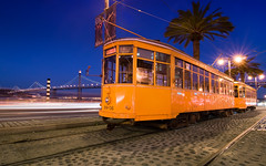 A Streetcar Named No Passengers (Matt Granz Photography) Tags: sanfrancisco california city bridge blue wallpaper urban public lights bay twilight dusk muni hour transportation postcards streetcar mattgranz
