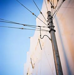Post & Wires -- San Francisco, CA (kzamani) Tags: sky urban white abstract lines post citylife wires fragment kodakektar100 mamiya675mmf35g
