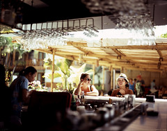 [Film 4x5] Red Cocobar, Boracay, Philippines (genotypewriter) Tags: girls film bar women fuji dof bokeh philippines tourist resort alcohol 4x5 boracay e6 largeformat astia 100f xenotar rap100f redcoconut redcocobar