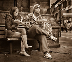 Fishy Mono Moment (pickup2sticks 1.42 million + Views)) Tags: street city people urban bw woman man fashion sepia mono nikon couple jeans takeaway toned tamron seated derby fishchips d7000 gjkerr