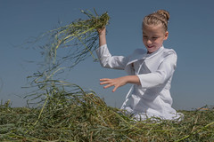 Funny Girl (thomas druyen) Tags: portrait girl smile face hair children hands hand outdoor portrt gras landschaft mdchen heu haare kommunion