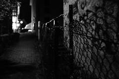 A dark way (stefankamert) Tags: light blackandwhite bw night fence dark way blackwhite lowlight exposure noir fuji noiretblanc nacht availablelight fujifilm fixed bnw highiso baw x100 primelens schwarzweis alienskin mirrorless x100s stefankamert