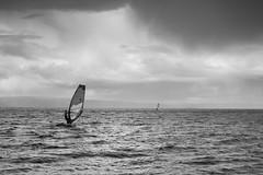 Wind surfing in rain (Helena Normark) Tags: norway norge surfing windsurfing trondheim srtrndelag a7 voigtlnder windsurfers trondheimsfjorden ranheim nokton5015 cv5015 nokton50mmf15 hansbakkfjra sonyalpha7