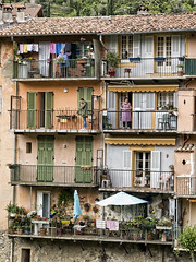 upstairs, downstairs, Sospel (plw1053) Tags: street houses people france architecture colours village candid balcony documentary veranda sospel plw1053 paullgwells