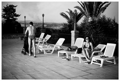 startled girl and man with red trunks and pushchair on phone (gorbot.) Tags: blackandwhite bw hotel f14 swimmingpool sicily roberta piazzaarmerina canoneos5d nikonfmount planar5014zf silverefex carlzeisszf50mmplanarf14 eosadaptor agriturismogigliotto