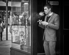 no smoking in this entrance (Andre Delhaye) Tags: street boy portrait england man streetphotography olympus smoking andre forbidden lad nosmoking olympuspen zuiko 45mm ep3 blackandwhitephotography m43 mft blackandwhitephotographs blackandwhitepictures blackandwhitephotographer micro43 microfourthirds 45mm18 43 andredelhaye andredelhayecom olympusdigitalpen blackandwhitephotographypictures blackandwhitephotographers andredelhayenet olympusep3 andredelhayephotographer penep3 olympusm45mmf18 olympusmzuikodigital45mm118 olympus45mm18