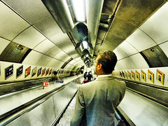 Going underground, I'm going underground! (Steve Taylor (Photography)) Tags: pictures uk england london art station londonbridge painting underground lights vanishingpoint gallery looking britain centre escalator tube perspective down ceiling tiles gb walls middle se1 adverts movingstaircase movingstairs goingunderground blinkagain