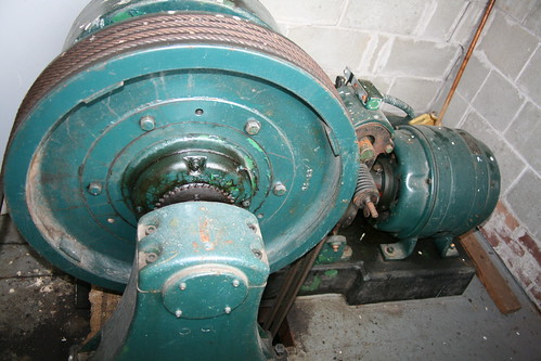 Geared elevator traction sheave and hoist motor