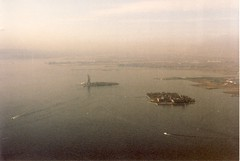 The Statue of Liberty and Ellis Island from The World Trade Center, 1984. (JL1967) Tags: nyc newyorkcity usa manhattan worldtradecenter 1984 wtc statueofliberty canonae1 ellisisland