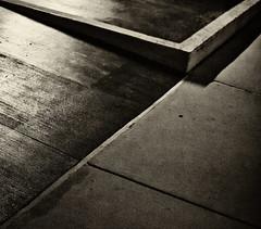 Soft Symmetry (Junk Story) Tags: blackandwhite blur sepia concrete triangle experimental pavement clayton grain shapes monotone sidewalk saintlouis parallellines nikond3100
