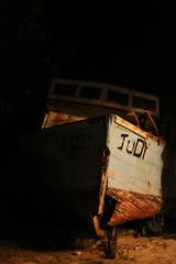 Judy (batmanday97) Tags: ocean lighting wood blue light red brown water canon rebel boat junk ship row dirty dirt shipwreck barbados rowboat motor judy wreck motorboat t1i canonrebelt1i