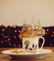 Splish Splash Sploosh (puremaguire) Tags: coffee tea bokeh biscuit mug splash cookiesplashphotography cockeralmugshannonbridgepotteryireland