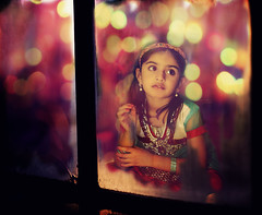 dreamland1 (totalsiddharth) Tags: pink winter india window glass colors girl festival night canon 50mm dress indian dream surreal celebration ethereal lonely through unreal dreamland xsi siddharth sharma