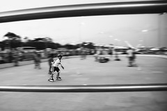 Kid On Wheels (VinothChandar) Tags: people bw india motion beach wheel statue kids speed marina canon children photography photo coach movement photos skating wheels class gandhi rink coaching marinabeach chennai panning learn tamilnadu classes mylapore canoneos5dmarkii chennaimarinabeach