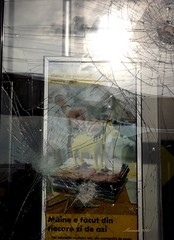 Store Window after Yesterday's Protests from Bucharest (marinela 2008) Tags: broken window glass sign store centre protest romania shopwindow yesterday magazin bucharest bucuresti spart vitrina fereastra geam sticla uniriisquare marinela2008 urmare nearcocorul